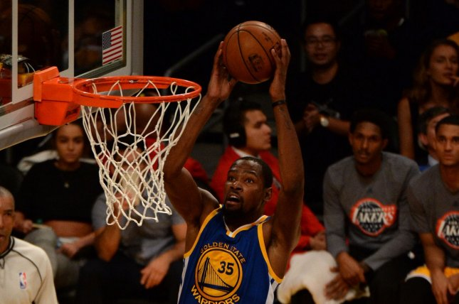 Golden State Warriors forward Kevin Durant dunks. Durant finished with 29 points in a playoff tune-up game. File photo by Jon SooHoo/UPI