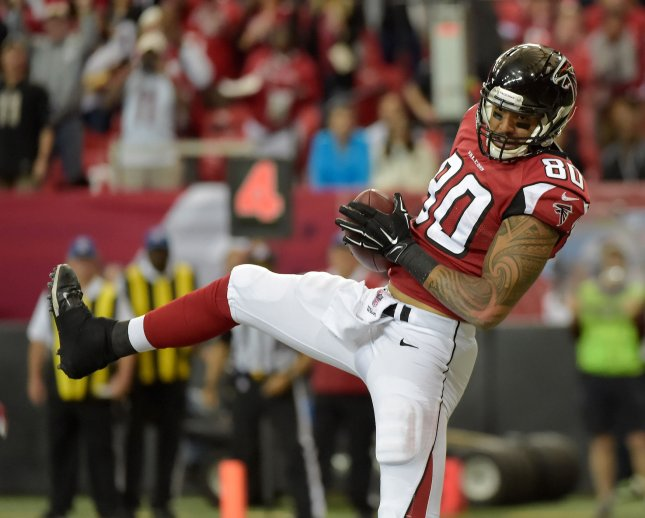 Former Atlanta Falcons tight end Levine Toilolo makes a touchdown catch during a game against the Arizona Cardinals in 2014. File photo by David Tulis/UPI