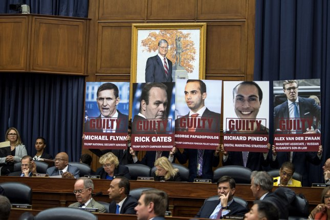 Rep. Elija Cummings, D-MD, delivers his opening statement alongside posters of Trump campaign officials under investigation by special counsel Robert Mueller, during a House Judiciary and Oversight Committees joint hearing on FBI and Department of Justice actions surrounding the 2016 election. Photo by Kevin Dietsch/UPI