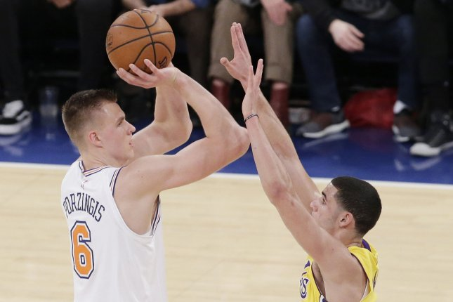 f5d476b6f82520 New York Knicks forward Kristaps Porzingis (L) is likely headed to the  Dallas Mavericks after the teams agreed to a trade Thursday afternoon.