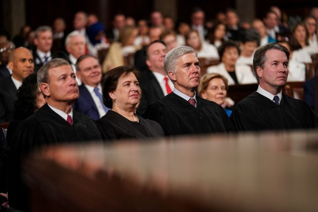 Supreme Court Justices John Roberts, Elena Kagan, Neil Gorsuch and Brett Kavanaugh listen during President Donald Trump's State of the Union address in February. The justices heard oral arguments Wednesday relating to a murder conviction in Mississippi. File Photo by Doug Mills/UPI