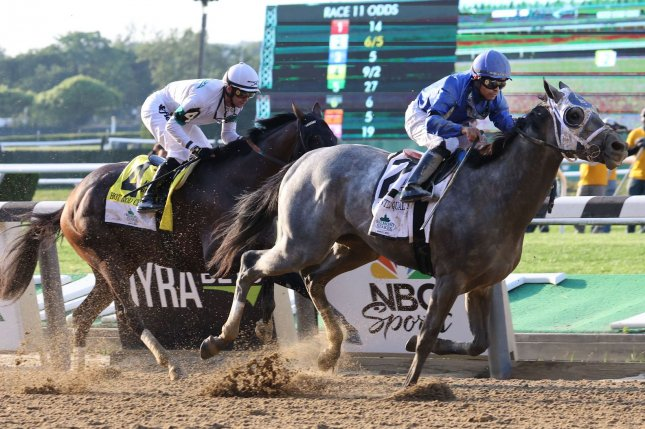 Essential Quality, ridden by Luis Saez, passes Hot Rod Charlie to win the 153rd running of the Belmont Stakes at Belmont Park in New York on Saturday. Photo by Mark Abraham/UPI