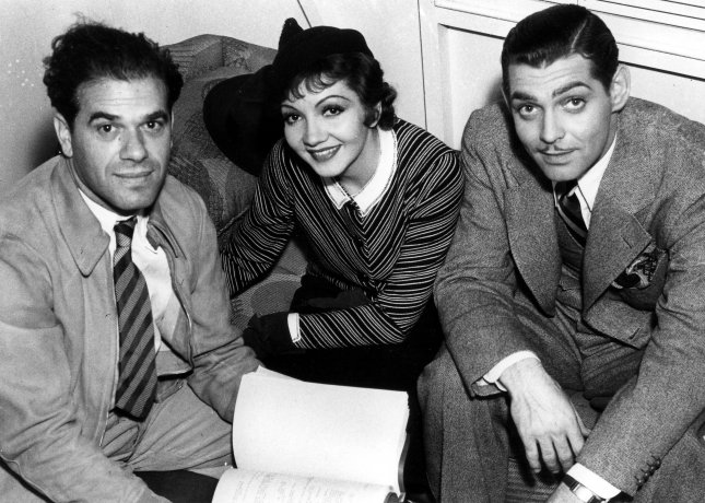 Director Frank Capra (L) is seen here in this 1933 picture with Claudette Colbert and legendary film actor Clark Gable.