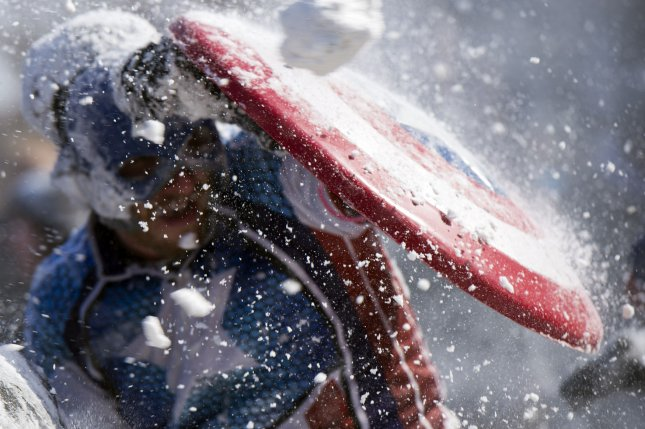A man dressed as Captain America stops a snowball with his shield during a snowball fight organized on social media, at Meridan Hill Park in Washington, D.C., February 17, 2015. A President's Day snow storm dropped 3-6 inches of snow on the D.C. region. Photo by Kevin Dietsch/UPI
