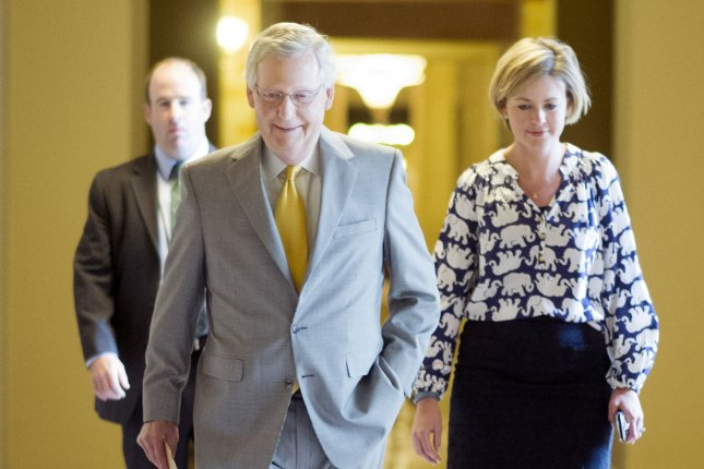 Senate Majority Leader Mitch McConnell, R-Ky., walks to the Senate chambers prior to a Senate vote on the USA Freedom Act during a rare Sunday session on Capitol Hill in Washington, D.C. on May 31, 2015. Three intelligence tools in the Patriot Act, including the NSA's bulk collection of Americans' phone records, expired later that night after parliamentary maneuvering by Kentucky Sen. Rand Paul. Senators voted on Tuesday, June 2, 2015 to pass the USA Freedom Act, rejecting three amendments McConnell had backed. Photo by Kevin Dietsch/UPI