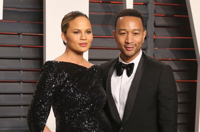 Chrissy Teigen (L) and John Legend at the Vanity Fair Oscar party on February 28. File Photo by David Silpa/UPI