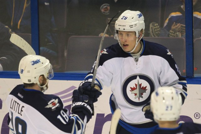 Winnipeg Jets Patrik Laine (R) potted his third hat trick of the season in leading his team to a much-needed 5-2 victory over the Dallas Stars. File Photo by Bill Greenblatt/UPI