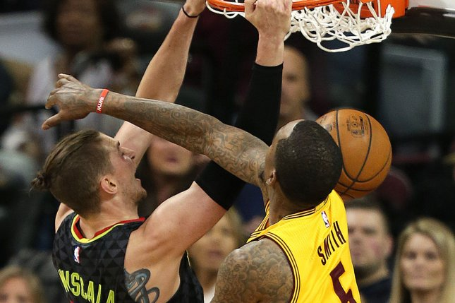 Atlanta Hawks Mike Muscala dunks over Cleveland Cavaliers' J.R. Smith during the second half at Quicken Loans Arena in Cleveland on April 7, 2017. Atlanta stunned the Cavaliers again on Sunday, coming back from a 26-point deficit to win in overtime. Photo by Aaron Josefczyk/UPI
