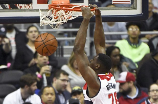 Washington Wizards center Ian Mahinmi (28) dunks the ball against the Brooklyn Nets in the first half at the Verizon Center in Washington, D.C. on March 24, 2017. File photo by Mark Goldman/UPI