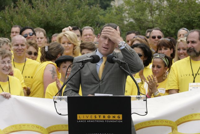 Former cycling star Lance Armstrong of the United States speaks at a news conference outside of the U.S. Capitol in Washington, D.C. Armstrong retired from cycling in 2011 and is now engaged to longtime girlfriend Anna Hansen. File photo by Yuri Gripas/UPI