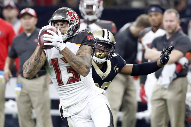 Tampa Bay Buccaneers wide receiver Mike Evans (13) grabs a Ryan Fitzpatrick pass for 12 yards in front of New Orleans Saints linebacker Demario Davis (56) on September 9, 2018 at the Mercedes-Benz Superdome in New Orleans. Photo by AJ Sisco/UPI