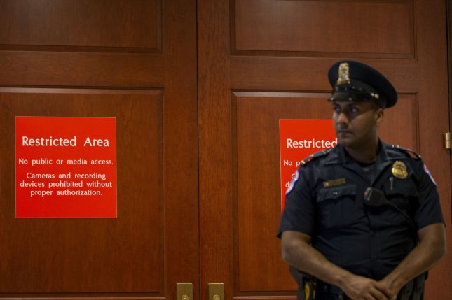 US Capitol Police Officer stands at the closed-door House Intelligence Committee meeting where former U.S. Special Envoy for Ukraine Kurt Volker is being interviewed. Photo by Tasos Katopodis/UPI