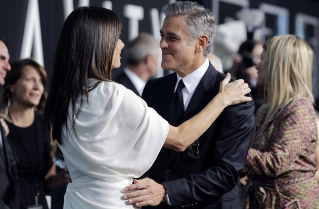 Sandra Bullock and George Clooney arrive on the red carpet at the New York Premiere of Gravity at AMC Lincoln Square in New York City on October 1, 2013. UPI/John Angelillo