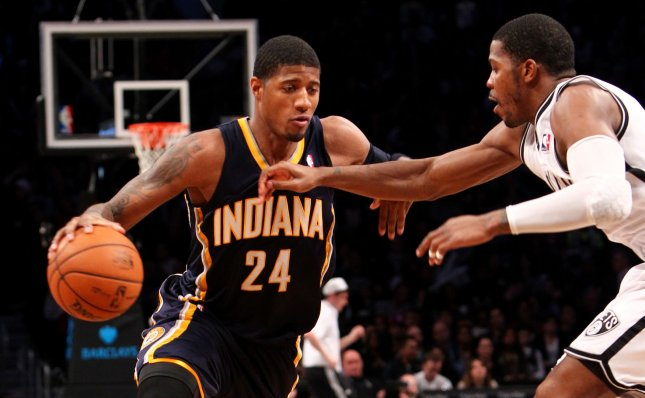 Indiana Pacers forward Paul George (24) drives to the basket against Brooklyn Nets guard Joe Johnson (7) in a January game George on Tuesday was voted the NBA's Most Improved Player for 2012-13. UPI/Nicole Sweet