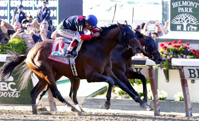Tonalist beats Commissioner by a head at the finish to win the 146th running of the Belmont Stakes in Elmont New York on June 7, 2014. California Chrome came in fourth place and failed to become the first horse in 36 years to win the Triple Crown. UPI/John Angelillo