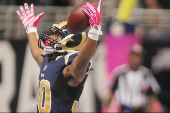 St. Louis Rams Todd Gurley holds his hands up after scoring a touchdown against the Cleveland Browns in third quarter at the Edward Jones Dome in St. Louis on October 25, 2015. St. Louis won the game 24-6. Photo by Bill Greenblatt/UPI