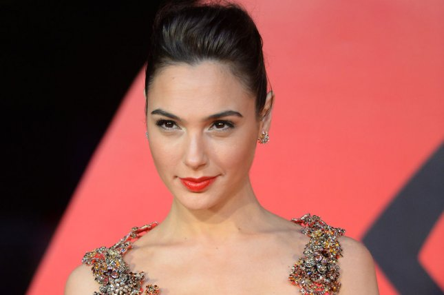 Gal Gadot attending the premiere of Batman v Superman: Dawn Of Justice at Odeon in London on March 22, 2016. Warner Bros. has moved up the release date of Gadot's next film, Wonder Woman and has also delayed their film adaptation of Jungle Book. File Photo by Rune Hellestad/ UPI