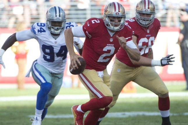 San Francisco 49ers QB Blaine Gabbert (2) scrambles away from Dallas Cowboys Randy Gregory (94) in the second quarter at Levi's Stadium in Santa Clara, California on August 23, 2015. The 49ers defeated the Cowboys 23-6 in their pre season game. Photo by Terry Schmitt/UPI