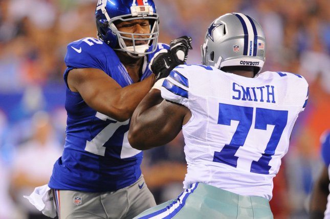 Former New York Giants defensive end Osi Umenyiora (72) applies pressure to Dallas Cowboys tackle Tyron Smith (77) in the second quarter in Week 1 of the NFL season on September 5, 2012 at MetLife Stadium in East Rutherford, New Jersey. File photo by Rich Kane/UPI