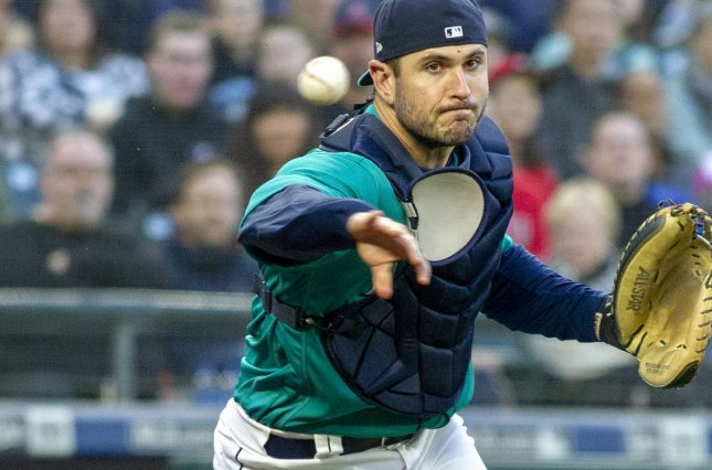 Seattle Mariners catcher David Freitas throws out Los Angeles Angels' batter Andrelton Simmons in the second inning on May 4 at Safeco Field in Seattle, Wash. Photo by Jim Bryant/UPI