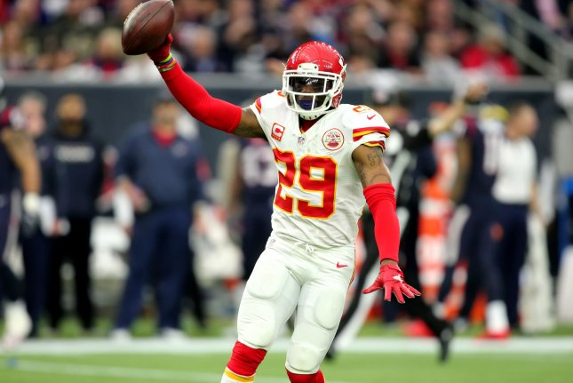 Kansas City Chiefs safety Eric Berry holds up the ball after an interception during a game against the Houston Texans. Photo by Erik Williams/UPI