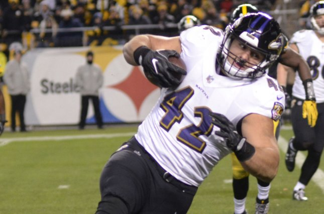 Baltimore Ravens fullback Patrick Ricard (42) runs to the right past Pittsburgh Steelers linebacker Sean Spence (51) to score in the fourth quarter on December 10, 2017 at Heinz Field in Pittsburgh. Photo by Archie Carpenter/UPI