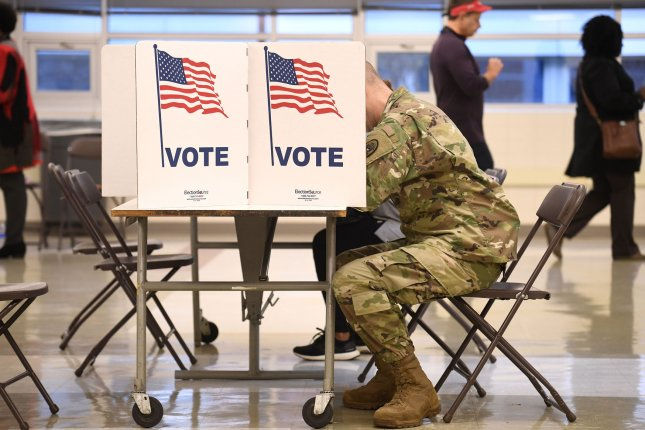 A military service member votes in Alexandria, Va., during the United States midterm elections on November 6, 2018. File Photo by Mike Theiler/UPI