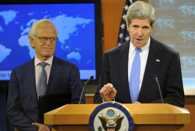 U.S. Secretary of State John Kerry (R) announces the resumption of peace talks to be headed by former American Ambassador to Israel Martin Indyk, (L), between Israel and the Palestinian Authority during a briefing at the State Department, July 29, 2013, in Washington, DC. Kerry will be meeting later in the evening with Israeli Justice Minister Tzipi Livni and Palestinian Chief Negotiator Saeb Erekat in an attempt to lay the ground work for progress in the Middle East. UPI/Mike Theiler