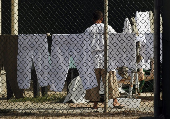 A detainee washes his clothing at Camp IV in Camp Delta at Naval Station Guantanamo Bay in Cuba on July 8, 2010. Some choose to wash their own clothing to ensure they keep the same items. UPI/Roger L. Wollenberg