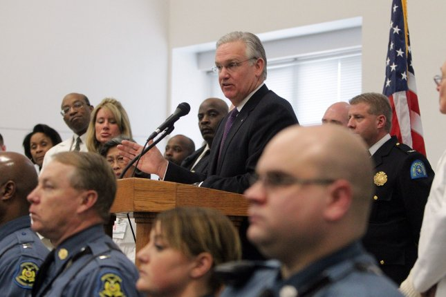 Flanked by law enforcement officials and health professionals, Missouri Governor Jay Nixon details a new plan on the impact of strengthening Medicaid on mental health, in St. Louis. A report by the Missouri Department of Mental Health found that strengthening Medicaid will strengthen public safety. UPI/Bill Greenblatt
