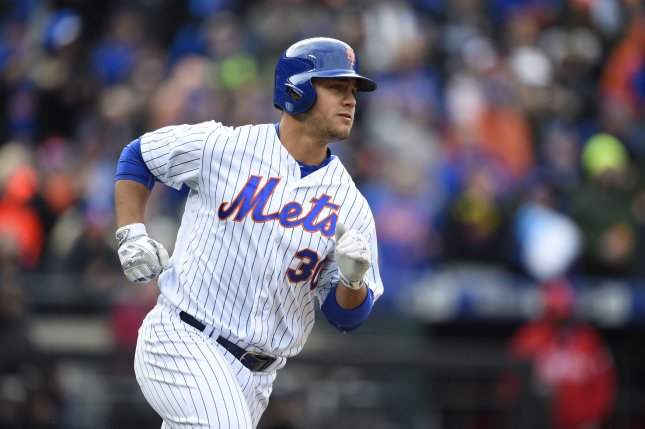 New York Mets left fielder Michael Conforto (30) rounds first in the 7th inning after a 2 run RBI single.. Photo by Rich Kane/UPI