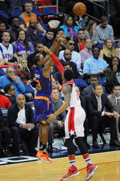 Phoenix Suns guard Brandon Knight launches a 3-point shot in a game against the Washington Wizards. Photo by Mark Goldman/UPI