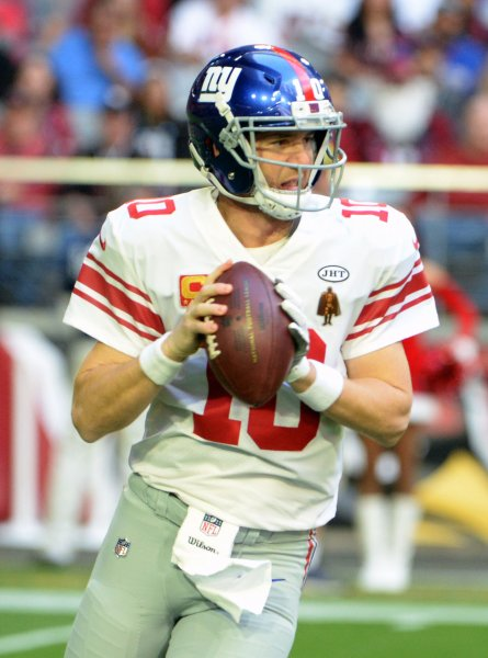 New York Giants quarterback Eli Manning sets to throw in the first quarter against the Arizona Cardinals during their game Dec. 24. Photo by Art Foxall/UPI