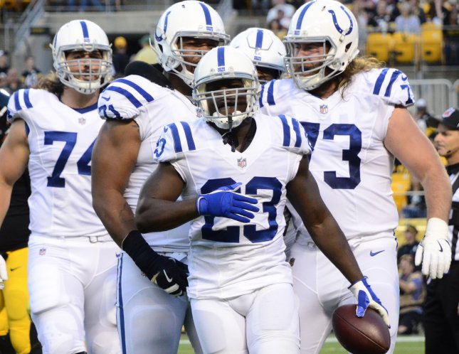Indianapolis Colts running back Frank Gore celebrates touchdown run against the Pittsburgh Steelers during a preseason game in August. Photo by Archie Carpenter/UPI