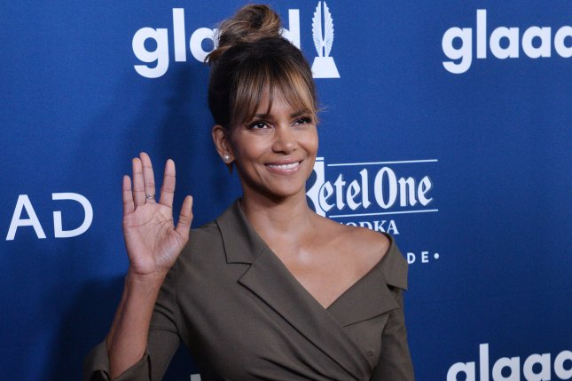 Halle Berry is in full costume alongside a pair of dogs in a new photo for John Wick: Chapter 3. File Photo by Jim Ruymen/UPI