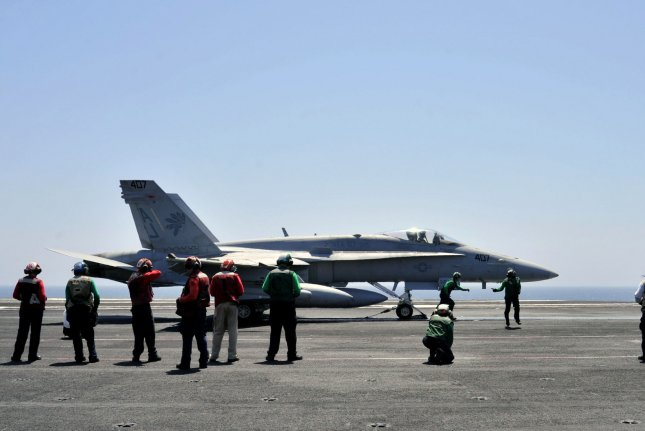 Sailors make final inspections on an F/A-18C Hornet on the flight deck of the aircraft carrier USS George H.W. Bush (CVN 77) of the U.S. 5th Fleet in the Persian Gulf in August 2014. File Photo UPI/Lorelei Vander Griend/U.S. Navy