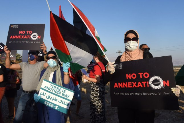 Activists protest plans by Israel to annex parts of the West Bank, during a rally at the Almog Junction near Jericho in the West Bank on June 27. Photo by Debbie Hill/UPI