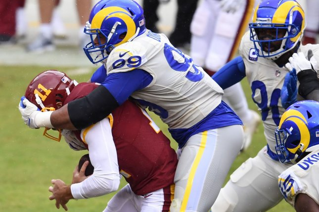 Los Angeles Rams defensive tackle Aaron Donald (99) sacked quarterback Alex Smith (11) three times in a win over the Washington Football Team on Sunday in Landover, Md. File Photo by Kevin Dietsch/UPI
