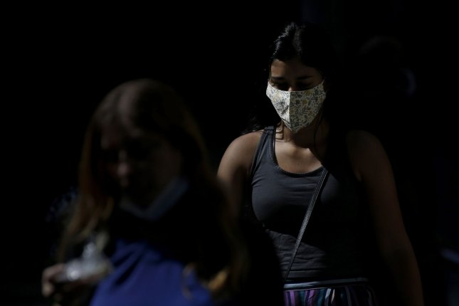 Utah Gov. Gary Herbert late Sunday issued a state of emergency ordering all residents to wear a mask when out in public or within six feet of someone they don't live with. Photo by John Angelillo/UPI