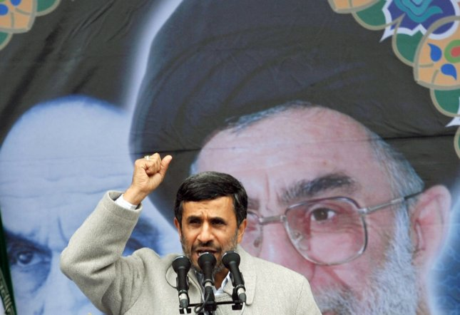Iranian President Mahmoud Ahmadinejad speaks in front of the pictures of Iran's late leader Ayatolah Khomeini (L) and Iran's current Leader Ayatolah Khamenei during the 32nd anniversary of the Islamic Revolution in Tehran, Iran on February 11, 2011. UPI/Maryam Rahmanian.
