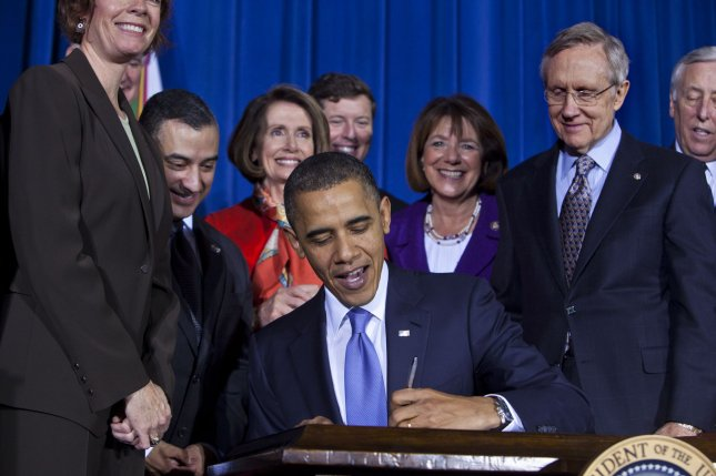 U.S. President Barack Obama, surrounded by lawmakers and bill supporters, signs into law the Don't Ask, Don't Tell Repeal Act of 2010, which will allow openly gay, lesbian, or bisexual soldiers to serve in the military, in a signing ceremony at the Department of the Interior in Washington on December 22, 2010. The repeal will take at least 60 days to go into effect, and has the backing of most of the military, including Defense Secretary Robert Gates. UPI/Jim Lo Scalzo/Pool