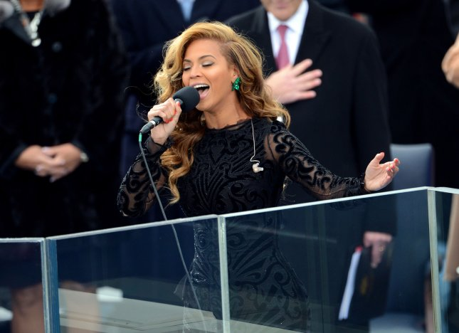 Beyonce sings the National Anthem after U.S. President Barack Obama is sworn-in for a second term by Supreme Court Chief Justice John Roberts during his public inauguration ceremony at the U.S. Capitol Building in Washington, D.C. on January 21, 2013. President Obama was joined by First Lady Michelle Obama and daughters Sasha and Malia. UPI/Kevin Dietsch