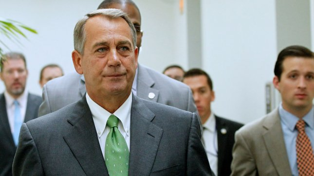 House Speaker John Boehner, R-Ohio, walks out of a press availability after the Republican Conference meeting in the U.S. Capitol, September 26, 2013. UPI/Molly Riley
