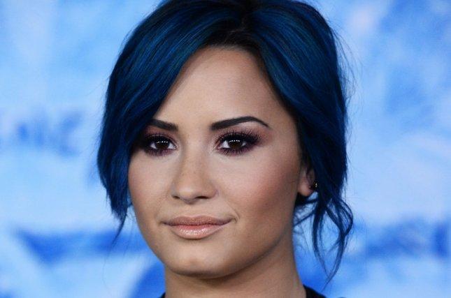 Singer Demi Lovato, who performs Let It Go in the film attends the premiere of the animated motion picture musical comedy Frozen at the El Capitan Theatre in the Hollywood section of Los Angeles on November 19, 2013. Storyline: Fearless optimist Anna teams up with Kristoff in an epic journey, encountering Everest-like conditions, and a hilarious snowman named Olaf in a race to find Anna's sister Elsa, whose icy powers have trapped the kingdom in eternal winter. UPI/Jim Ruymen
