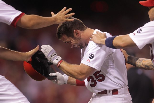 St. Louis Cardinals Greg Garcia is mobbed by teammates after taking a walk, resulting in the winning run crossing the plate against the Colorado Rockies in the ninth inning at Busch Stadium in St. Louis on July 30, 2015. St. Louis won the game 9-8. Photo by Bill Greenblatt/UPI