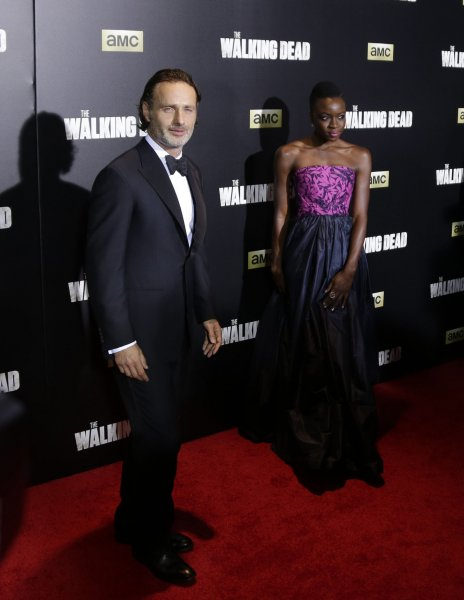Police surrounded the home of a family watching the midseason premier of The Walking Dead after neighbors reported hearing loud talking and gunshots coming from the home. Above, Andrew Lincoln and Danai Gurira arrive on the red carpet at the show's Season 6 fan premiere event last fall. FilePhoto by John Angelillo/UPI