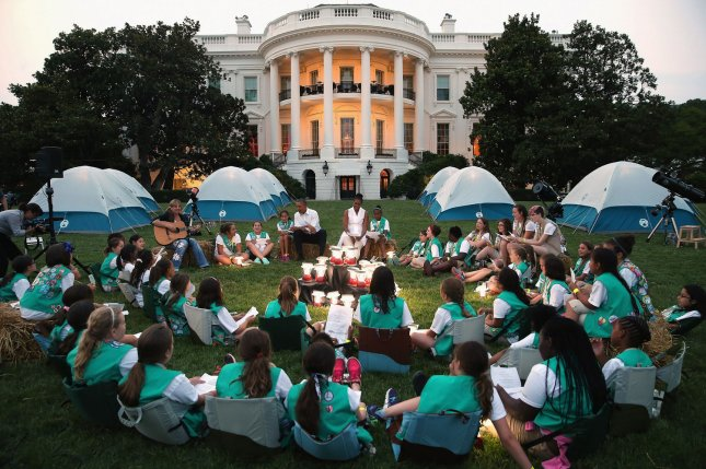 U.S. President Barack Obama and first lady Michelle Obama host a group of Girl Scouts for a campout on the South Lawn of the White House June 30, 2015. The Catholic Archdiocese of Kansas City, Kan., announced on Monday that the church will sever ties with the Girl Scouts organization. File Photo by Chip Somodevilla/UPI