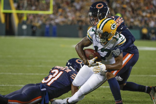 Green Bay Packers wide receiver Davante Adams (C) goes for a touchdown against Chicago Bears cornerback Marcus Cooper (L) and cornerback Bryce Callahan (R) during the first half Thursday at Lambeau Field in Green Bay, Wisc. Photo by Kamil Krzaczynski/UPI