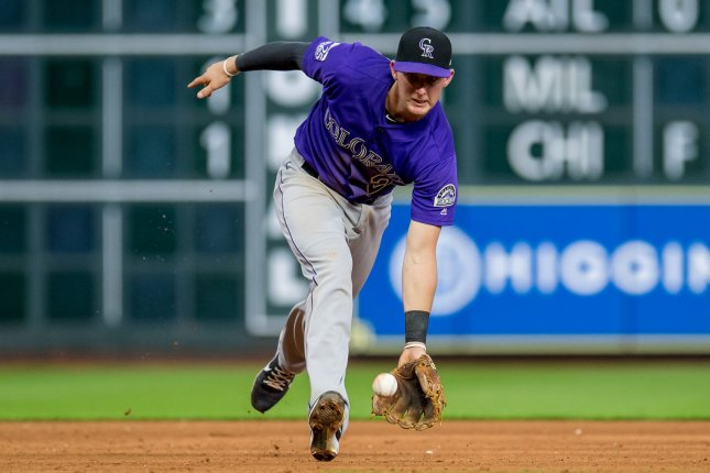 Colorado Rockies third baseman Ryan McMahon fields the ball prior to throwing to first to record an out against the Houston Astros on August 15 at Minute Made Park in Houston, Texas. Photo by Trask Smith/UPI