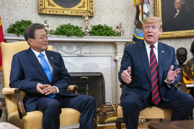 U.S. President Donald Trump (R) welcomes South Korean President Moon Jae-in to the Oval Office of the White House on Thursday. Photo by Jim Lo Scalzo/UPI